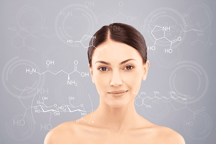brunette woman in front of blackboard with collagen protein molecular formula