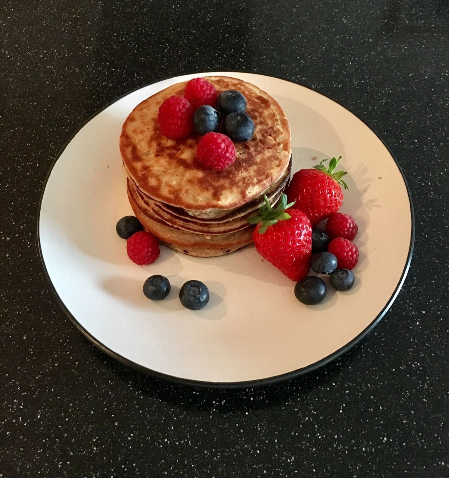 Protein smoothie pancakes with strawberries and blueberries